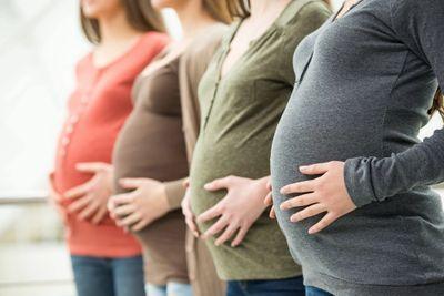 Four Women Holding Pregnant Bellies